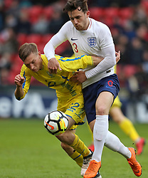 Ukraine U21's Valeriy Luchkevych (left) and England U21's Ben Chilwell battle for the ball during the UEFA European U21 Championship Qualifying, Group 4 match at Bramall Lane, Sheffield.