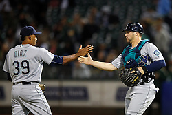 OAKLAND, CA - SEPTEMBER 09:  Edwin Diaz #39 of the Seattle Mariners celebrates with Mike Zunino #3 after the game against the Oakland Athletics at the Oakland Coliseum on September 9, 2016 in Oakland, California. The Seattle Mariners defeated the Oakland Athletics 3-2. (Photo by Jason O. Watson/Getty Images) *** Local Caption *** Edwin Diaz; Mike Zunino