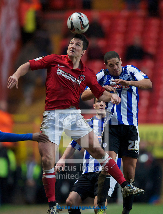 Picture by Alan Stanford/Focus Images Ltd +44 7915 056117.26/01/2013.Yann Kermorgant of Charlton Athletic and Giles Coke of Sheffield Wednesday during the npower Championship match at The Valley, London.