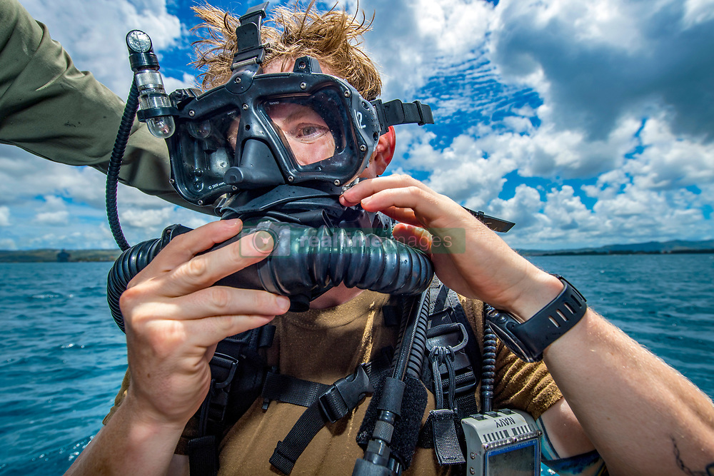 181003-N-VR594-1125<br /> <br /> SANTA RITA, Guam (Oct. 03, 2018) Explosive Ordnance Disposal Technician 1st Class Nic Gorsuch, assigned to Explosive Ordnance Disposal Mobile Unit (EODMU) 5, dons a Mark 16 Mod 1 closed-circuit mixed-gas underwater breathing apparatus during a supervisor certification dive aboard a rigid-hull inflatable boat. EODMU 5 conducts counter improvised explosive device operations, renders safe explosive hazards and disarms underwater explosives. EODMU 5 is assigned to Commander, Task Force 75, the primary expeditionary task force responsible for the planning and execution of coastal riverine operations, explosive ordnance disposal, diving engineering and construction, and underwater construction in the U.S. 7th Fleet area of operations. (U.S. Navy photo by Mass Communication Specialist 2nd Class Kelsey J. Hockenberger)