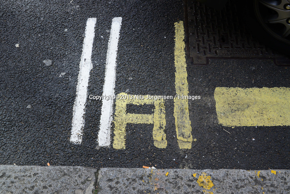 Shortest double yellow lines in UK.  Measuring just over nine inches long, the double yellow lines in Caxton Street, Westminster, central London, between a taxi rank and some parking bays, are thought to be the shortest in the UK. London, United Kingdom. Sunday, 1st September 2013. Picture by Nils Jorgensen / i-Images