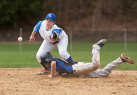 Winnisquams Jordan Riberdy tags the plate ahead of the throw to Inter Lakes Brian Borders during Thursdays NHIAA Division III varsity baseball game.  (Karen Bobotas/for the Laconia Daily Sun)
