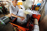 Masaru Goto, 73, pushes garbage into a compression machine as part of his daily chores at the waste disposal site in central Kamikatsu Town in Shikoku, Japan. The town, whose residents number just over 2,000 people, has implemented a waste recycling policy that aims at eliminating waste entirely within the next 12 years and employs retired local residents to care for the waste disposal center.