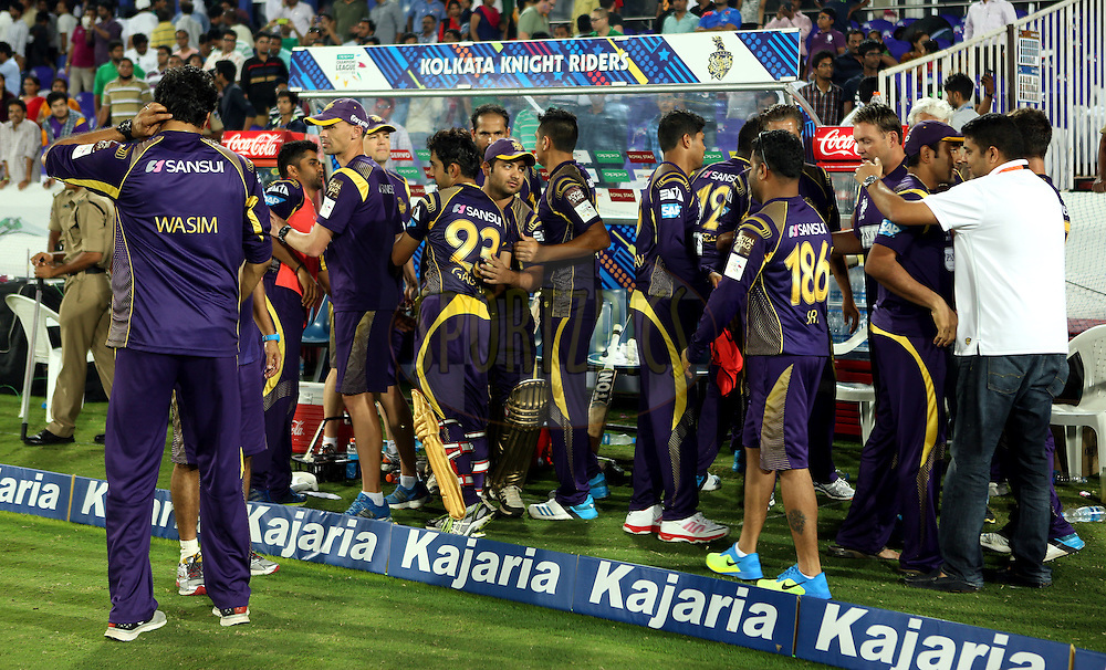 Players of Kolkatta Knight Riders in dugout celebrates after winning the match 7 of the Oppo Champions League Twenty20 between the Kolkata Knight Riders and the Lahore Lions held at the Rajiv Gandhi Cricket Stadium, Hyderabad, India on the 21st September 2014<br /> <br /> Photo by:  Sandeep Shetty / Sportzpics/ CLT20<br /> <br /> <br /> Image use is subject to the terms and conditions as laid out by the BCCI/ CLT20.  The terms and conditions can be downloaded here:<br /> <br /> http://sportzpics.photoshelter.com/gallery/CLT20-Image-Terms-and-Conditions-2014/G0000IfNJn535VPU/C0000QhhKadWcjYs
