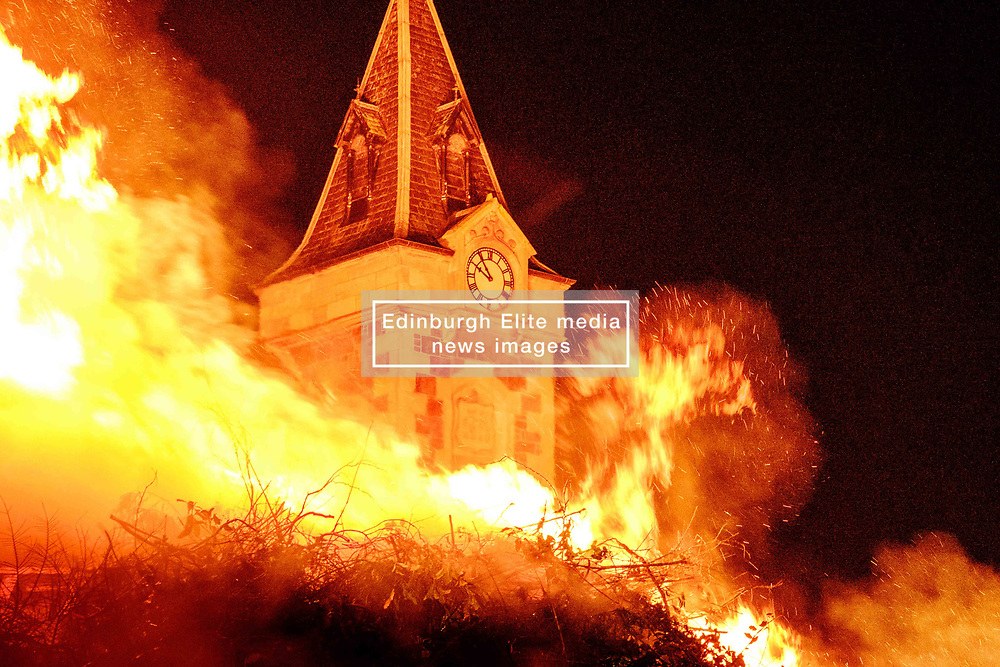 Biggar, South Lanarkshire, Scotland.  The spectacular hogmanay bonfire in the town's High Street was set ablaze at 9.30pm on hogmanay watched by a crowd of several thousand.  It is the biggest hogmanay bonfire in the country and a continuing tradition dating back hundreds of years.  The fire was set alight by local resident Mrs. Dorothy Frame.<br /> <br /> (c) Andrew Wilson   Edinburgh Elite media
