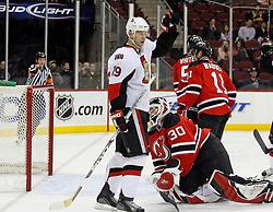 February 13, 2008; Newark, NJ, USA;  Ottawa Senators center Jason Spezza (19) celebrates a goal by Ottawa Senators defenseman Luke Richardson (2) during the first period at the Prudential Center in Newark, NJ.