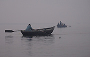 Varanasi - Wednesday, Jan 10 2007: Boats in the early morning mist on the River Ganges at Varanasi. (Photo by Peter Horrell / http://www.peterhorrell.com)