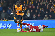 Nottingham Forest defender Matt Mills(5) grabs at the feet  Hull City midfielder Mohammed Diame (17) as he makes his way forward during the Sky Bet Championship match between Hull City and Nottingham Forest at the KC Stadium, Kingston upon Hull, England on 15 March 2016. Photo by Ian Lyall.