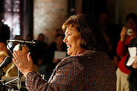 Connie Broom (cq) speaks to people gathered at The Spotted Dog--which used to house Fire Station 11--during a commemoration to mark the 60th anniversary of the Winecoff Hotel fire in downtown Atlanta. Broom, 1 year old at the time, was staying at the hotel on the night of the fire with her parents, Margaret and Warren E. Foster (both cq). They all survived. The fire--at 119 deaths, the worst hotel fire in U.S. history--caused departments across the country to update their safety codes.