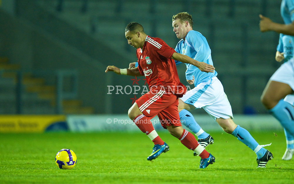 WARRINGTON, ENGLAND - Monday, November 3, 2008: Liverpool's Nabil El Zhar passes Manchester City's Michael Ball on his way to scoring a goal during the Premiership Reserve League match at the Halliwell Jones Stadium. (Photo by David Rawcliffe/Propaganda)