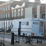 The NHS MXU van is parked up outside St Mungo's hostel near King's Cross. .The rates of tuberculosis in London are higher than any other Western European capital and is a major health problem. Tuberculosis is highly contagious, it is treatable, but in the event of no treatment it is often deadly. The MXU, the Mobile X-ray Unit, is a facility run by the NHS. The MXU is a Tuberculosis screening service on wheels where people can have their chest x-rayed and within minutes be either cleared of TB - or in case of any TB symptoms showing up on the X-rays, be referred to a hospital for further tests and possible treatment. The MXU is aimed at hard to reach groups like homeless people, drug or alcohol abuser and prisoners. The van is the only one in the UK and operates around London where it visits hostels, prisons and community centres where groups of hard to reach clients usually gather. On the van is a team of nurses, radiographers, social and outreach workers and expert technicians. The MXU van is a part of the NHS department Find and Treat..