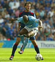 Photo Aidan Ellis.<br />Manchester City v Portsmouth.<br />FA Barclaycard Premiership.<br />23/08/2003.<br />Pompey's Patrick Berger watches City's Paulo Wanchope.