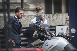 © Licensed to London News Pictures. 13/07/2017. London, UK. Chris Gard (L) and Connie Yates (R) talks with their advisors outside Court after leaving the court during proceedings. The parents of terminally ill Charlie Gard have returned to the High Court in light of new evidence relating to potential treatment for their son's condition. An earlier lengthy legal battle ruled that Charlie could not be taken to the US for experimental treatment. London, UK. Photo credit: Peter Macdiarmid/LNP