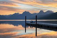 Couple on dock at Sunrise at Lake McDonald Glacier National Park Montana