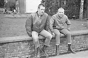 Two skinheads sat on a wall, High Wycombe, UK, 1980s