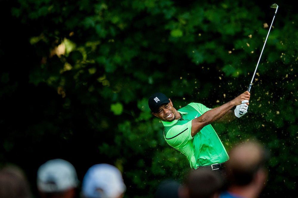 Tiger Woods tees off on the 13th hole during the first round of the Quicken Loans National golf tournament on Wednesday at Congressional Country Club in Bethesda, Maryland. This marked  Woods' return to competition for the first time in three months after having surgery just a week before the Masters in April of this year.