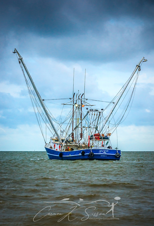 "The Sea Quest shrimp boat heads out of Bayou La Batre, Alabama, May 16, 2015, for an evening of shrimping. The boat is based in Eastpoint, Fla. Bayou La Batre is known as the ""Seafood Capital of Alabama."" (Photo by Carmen K. Sisson/Cloudybright)"