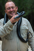 Eastern Indigo Snake (Drymarchon couperi) & Dirk Stevenson<br /> CAPTIVE<br /> The Orianne Indigo Snake Preserve<br /> Telfair County, Georgia<br /> USA<br /> HABITAT & RANGE: Long leaf pine sandhills of central plains of Georgia, southern South Carolina south through Florida and west to Louisiana, Mississippi, and Alabama that are populated with Gopher Tortoises.<br /> Federally listed as THREATENED SPECIES