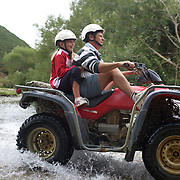 A father and daughter Quad biking at Happy Valley Adventures, Cable Bay Rd. Nelson New Zealand, 30th January  2011, Photo Tim Clayton.
