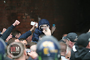 Manchester UK 11.06.2017 A worried looking child was seen at the UK Against Hate demo in Manchester today where 400 police many in riot gear had to keep protestors apart. The location this phone was taken riot police were holding back protestors who were throwing bottles and  making racist remarks.