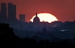 © Licensed to London News Pictures. 06/05/2020. London, UK. The sun rises behind St Paul's Cathedral in Central London heralding the start of a few days of warm temperatures leading to the May bank holiday weekend. Prime Minister Boris Johnson is expected to announce changes to the lockdown later this week. Photo credit: Peter Macdiarmid/LNP