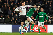 Tom Lawrence (10) catches Steven Fletcher (9) during the EFL Sky Bet Championship match between Derby County and Sheffield Wednesday at the Pride Park, Derby, England on 11 December 2019.