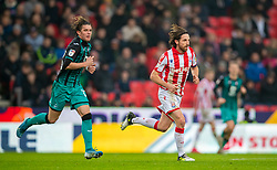 STOKE-ON-TRENT, ENGLAND - Saturday, January 25, 2020: Stoke City's captain Joe Allen (R) and Swansea City's Conor Gallagher during the Football League Championship match between Stoke City FC and Swansea City FC at the Britannia Stadium. (Pic by David Rawcliffe/Propaganda)