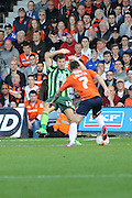 Bayo Akinfenwa of AFC Wimbledon and Alex Lawless during the Sky Bet League 2 match between Luton Town and AFC Wimbledon at Kenilworth Road, Luton, England on 26 September 2015. Photo by Stuart Butcher.