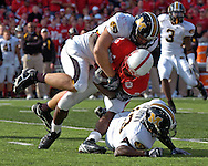 Missouri linebacker Brock Christopher (top) wraps up Nebraska running back Brandon Jackson (32) in the fourth quarter, over teammate Cornelius Brown (13) at Memorial Stadium in Lincoln, Nebraska, November 4, 2006.  The Huskers beat the Tigers 34-20.<br />