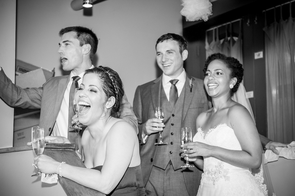 A bride and groom step aside for their siblings' toasts in Brattleboro, VT.