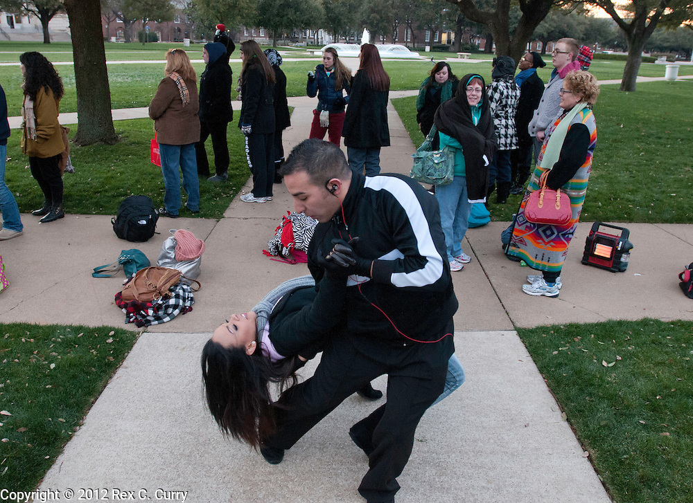 "Jazmin Krug, from Orlando, Fl. and jeremy Ramirez from Dallas, dance after meeting while waiting in the early morning cold to audition for ""So You Think You Can Dance"" at SMU on Friday, Jan. 13, 2012."