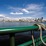Seattle Washington Skyline View From Ferryboat On Puget Sound With Boat Railing And Knotted Rope In Foreground<br />