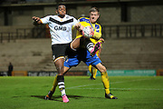 Maidenhead United defender Alan Massey and Port Vale forward Uche Ikpeazu during the The FA Cup match between Port Vale and Maidenhead United at Vale Park, Burslem, England on 8 November 2015. Photo by Jemma Phillips.