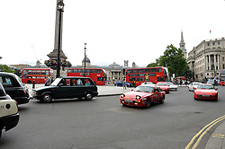 Image ©Licensed to i-Images Picture Agency. 18/06/2014. <br /> <br /> Pictured are the Porsche 944's travelling through Trafalgar Square leaving London for Norway.<br /> <br /> Nine Porsche 944's, all bought for £1100 of less, set of from the Mall, London on a rally across Northern Europe to Nordkapp in Norway in an attempt to raise £100,000 for Help For Heroes.<br /> <br /> Wednesday 18th June 2014<br /> Picture by Ben Stevens / i-Images