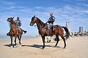 Israel, Tel Aviv Israeli mounted police patrol the beachfront