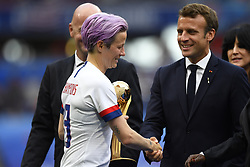 July 7, 2019 - Lyon, France - Megan Rapinoe (Reign FC) of United States shakes hands with Emmanuel Macron Head of State France before lifting the trophy after winning the 2019 FIFA Women's World Cup France Final match between The United State of America and The Netherlands at Stade de Lyon on July 7, 2019 in Lyon, France. (Credit Image: © Jose Breton/NurPhoto via ZUMA Press)