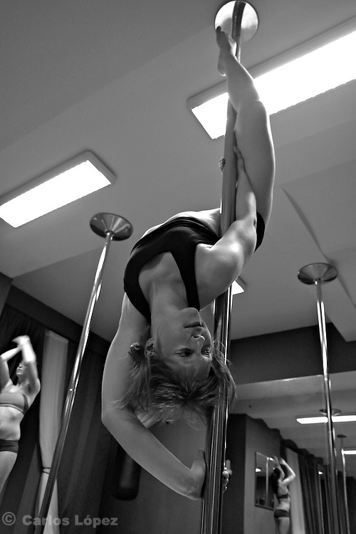 Students of pole dance from the school dance Citadela Mefisto during training, in the city of Brno, Czech republic...Pole dance has gained popularity as a sport in recent years around the world and in Czech republic started aprox.  years ago.
