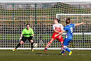 Brighton striker Fliss Gibbons shoots at goal during the FA Women's Premier League Cup quarter-final match between Brighton Ladies and Charlton Athletic WFC at The American Express Elite Football Performance Centre, Lancing, United Kingdom on 1 March 2015. Photo by Geoff Penn.