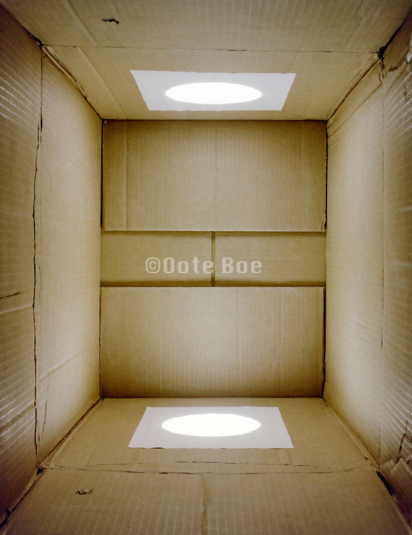cardboard box with white light shining in it