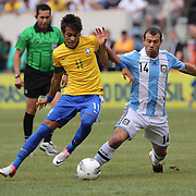 Neymar, Brazil, (left) is challenged by Javier Mascherano, Argentina, during the Brazil V Argentina International Football Friendly match at MetLife Stadium, East Rutherford, New Jersey, USA. 9th June 2012. Photo Tim Clayton2