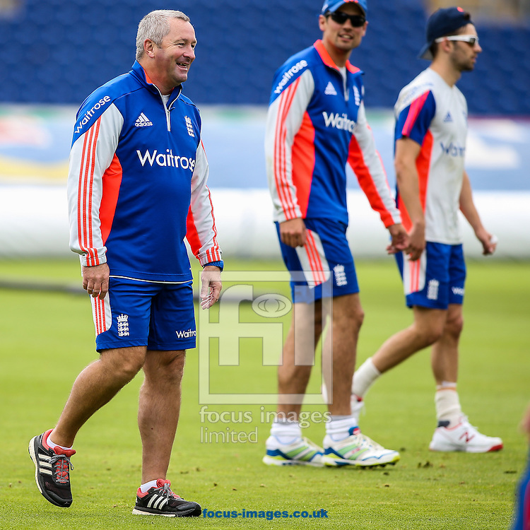 Assistant England head coach Paul Farbrace (left) smiles as England captain (centre) looks on during the England Cricket Practice before the first Test Match of the Investec Ashes Series at Sophia Gardens, Cardiff<br /> Picture by Andy Kearns/Focus Images Ltd 0781 864 4264<br /> 07/07/2015