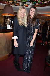 Left to right, ASTRID HARBORD and JENNIFER MEDHURST at a party hosted by Lady Kinvara Balfour, Lavinia Brennan and Lady Natasha Rufus Isaacs to celebrate the Beulah French Sole Collaboration in aid of the UN Blue Heart Campaign, held at George, 87-88 Mount Street, London on 10th December 2013.