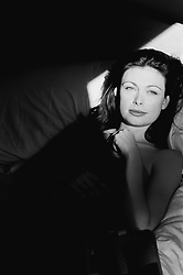 woman resting in bed with sunlight on her face