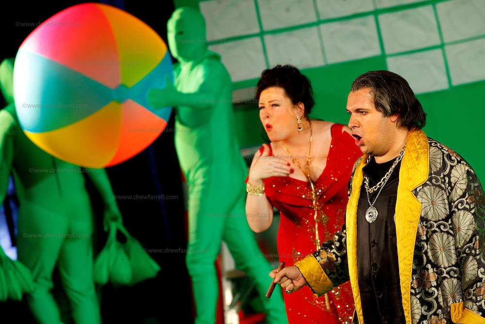 Picture shows : Karen Cargill as Isabella and Tiziano Bracci as Mustafa. Picture  ©  Drew Farrell Tel : 07721 -735041..A new Scottish Opera production of  Rossini's 'The Italian Girl in Algiers' opens at The Theatre Royal Glasgow on Wednesday 21st October 2009..(Soap) opera as you've never seen it before..Tonight on Algiers.....Colin McColl's cheeky take on Rossini's comic opera is a riot of bunny girls, beach balls, and small screen heroes with big screen egos. Set in a TV studio during the filming of popular Latino soap, Algiers, the show pits Rossini's typically playful and lyrical music against the shoreline shenanigans of cast and crew. You'd think the scandal would be confined to the outrageous storylines, but there's as much action off set as there is on.... .Italian bass Tiziano Bracci makes his UK debut in the role of Mustafa. Scottish mezzo-soprano Karen Cargill, who the Guardian called a 'bright star' for her performance as Rosina in Scottish Opera's 2007 production of The Barber of Seville, sings Isabella. .Cast .Mustafa...Tiziano Bracci.Isabella..Karen Cargill.Lindoro...Thomas Walker.Elvira...Mary O'Sullivan.Zulma...Julia Riley.Haly...Paul Carey Jones.Taddeo...Adrian Powter. .Conductors.Wyn Davies.Derek Clarke (Nov 14). .Director by Colin McColl.Set and Lighting Designer by Tony Rabbit.Costume Designer by Nic Smillie..New co-production with New Zealand Opera.Production supported by.The Scottish Opera Syndicate.Sung in Italian with English supertitles..Performances.Theatre Royal, Glasgow - October 21, 25,29,31..Eden Court, Inverness - November 7. .His Majesty's Theatre, Aberdeen  - November 14..Festival Theatre,Edinburgh - November 21, 25, 27 ...Note to Editors:  This image is free to be used editorially in the promotion of Scottish Opera. Without prejudice ALL other licences without prior consent will be deemed a breach of copyright under the 1988. Copyright Design and Patents Act  and will be subject to payment or legal action, where appropriate..Furth
