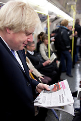 © Licensed to London News Pictures. 03/05/2012. LONDON, UK. London Mayor Boris Johnson talks to a member of the public as he travels on the Northern Line after casting his vote in the 2012 mayoral and council elections in London today (03/05/12). Photo credit: Matt Cetti-Roberts/LNP