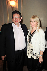 LUCIAN GRAINGE and his wife CAROLINE he is head of Universal Music at a dinner hosted by Vogue in honour of photographer David Bailey at Claridge's, Brook Street, London on 11th May 2010.