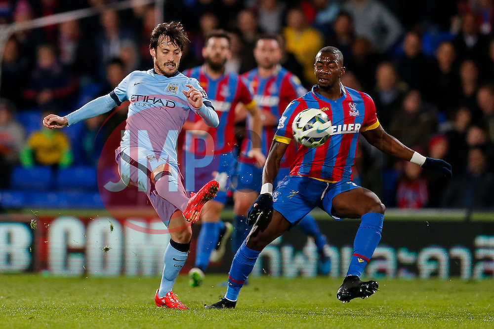 David Silva of Manchester City clears from Yannick Bolasie of Crystal Palace - Photo mandatory by-line: Rogan Thomson/JMP - 07966 386802 - 06/04/2015 - SPORT - FOOTBALL - London, England - Selhurst Park - Crystal Palace v Manchester City - Barclays Premier League.