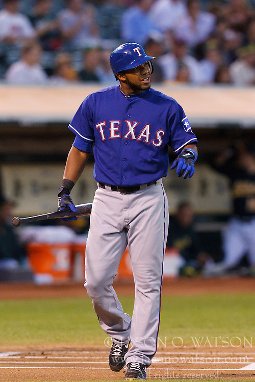 September 20, 2011; Oakland, CA, USA;  Texas Rangers shortstop Elvis Andrus (1) returns to the dugout after striking out against the Oakland Athletics during the first inning at O.co Coliseum.  Texas defeated Oakland 7-2.