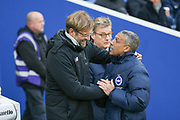 Liverpool manager Jurgen Klopp greets Brighton and Hove Albion manager Chris Hughton during the Premier League match between Brighton and Hove Albion and Liverpool at the American Express Community Stadium, Brighton and Hove, England on 2 December 2017. Photo by Phil Duncan.
