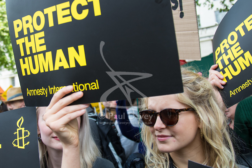 """Whitehall, London, May 30th 2015. Hundreds in """"Great British Right Off"""" protest against government plans to repeal the Human Rights act, seen as an obstacle to upholding British laws."""